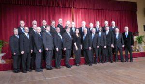Photo du Choeur d'Hommes d'Alsace Bossue lors du concert à Drulingen avec la chef de choeur